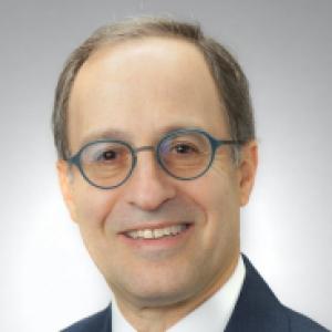 Robert Schoen in a black suit