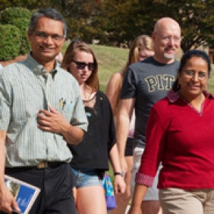 a group of people walking around campus