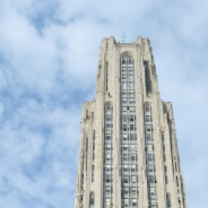 Cathedral of Learning against blue sky with clouds