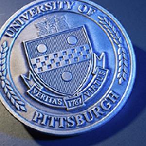 a photo of Pitt's seal, cast in a blue light