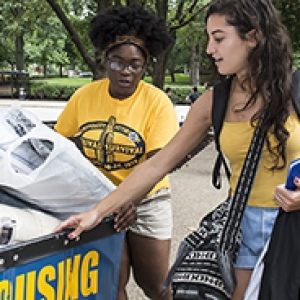 Two students push a housing cart on move-in day