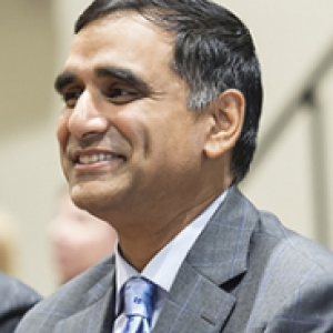 Hari Sastry in a gray suit and light blue tie