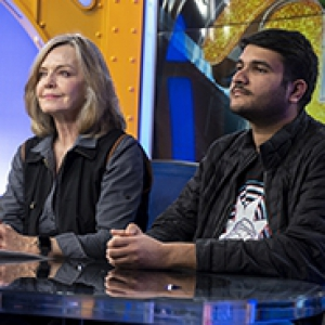 a woman and man at an anchor desk