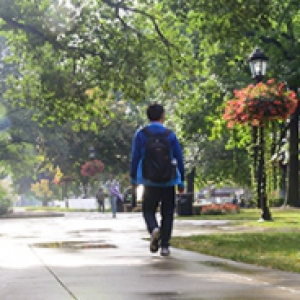 a person in blue walking near the Cathedral after a rain shower