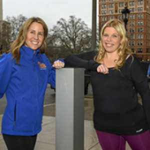 Two women in running gear outside Nordenberg Hall