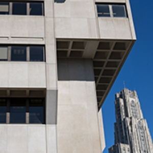 The side of a building, with the Cathedral of Learning in the background