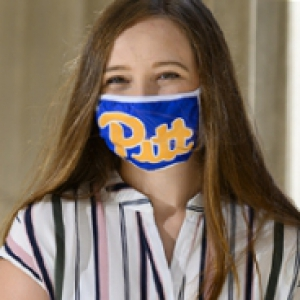 A woman in a striped top and a Pitt face mask