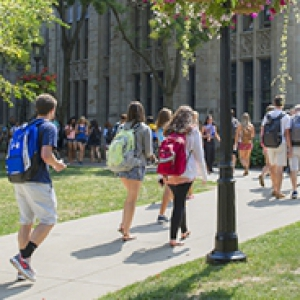 students walking on a sidewalk in front of the Cathedral