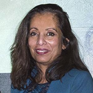 Maliha Zahid headshot with blue jacket and blouse