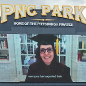 Rebecca Skloot in graduation gown on the PNC Park Screen