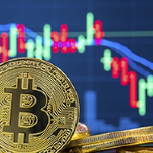 a coin with the bitcoin symbol printed on it, in front of a stock-market-looking graph