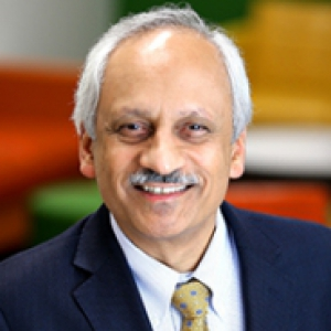 Anantha Shekhar in a dark blue suit