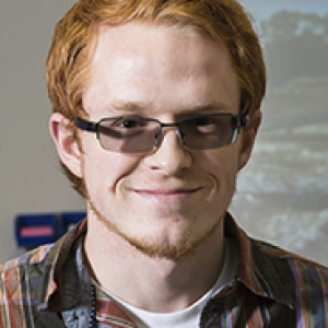 Dyer, a student with red hair and glasses