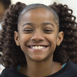 Young African-American girl smiling