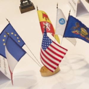 EU, PA, USA, and other flags on a white table