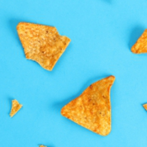 triangle chips that look like Doritos spread out on a blue background