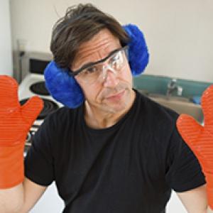 Steve Casner wearing blue ear protectors and orange hand protectors