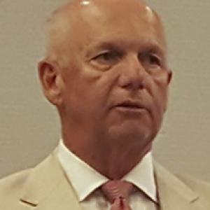 David Hickton in a tan suit jacket and salmon tie