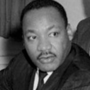 a black and white image of Dr. King
