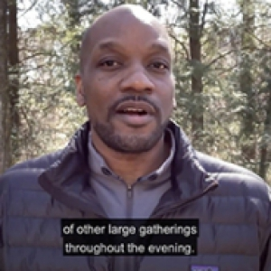 Kenyon Bonner in a blue jacket in front of trees