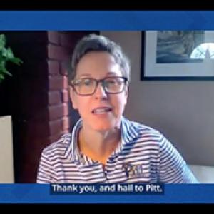 Kris Davitt in a striped shirt on a Zoom call