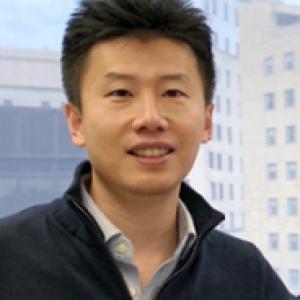 Yi Shi in a dark jacket