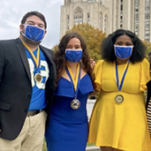 Pitt students in blue and gold linking arms