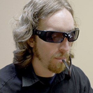 "man using BrainPort, a device that allows people with vision impairments to ""see"" using their tongue"