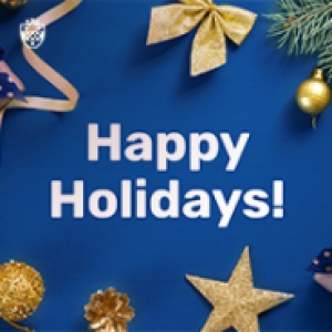 "A sign that reads, ""Happy Holidays!"" in white against a blue background with various holiday decorations"