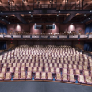 Empty theater with paper bags in each of its 500 seats