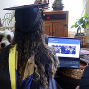 A family watches commencement online