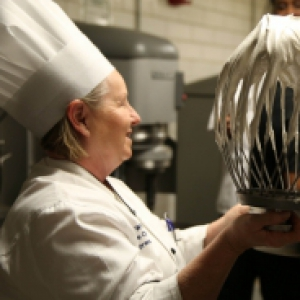 Humane Society Chef Wanda White offers up a large whip of aquafaba meringue cookie batter for the Pitt Dining chefs to sample.