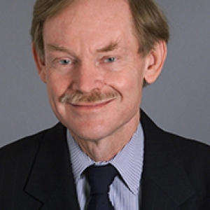 Robert Zoellick in a dress shirt and jacket