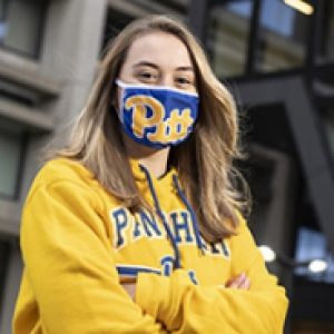 Julia Foust in a blue Pitt mask and a yellow panthers hoodie