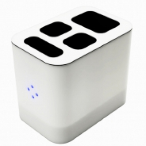 a sleek white device with four holes