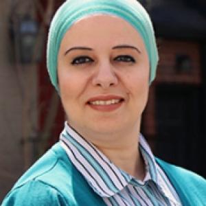 Samar El Khoudary in light blue headwear and a light blue top