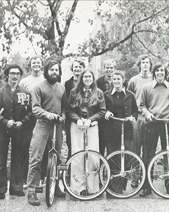 Historic photo from 1974 Owl Yearbook of students and unicycles in Unicycle Club